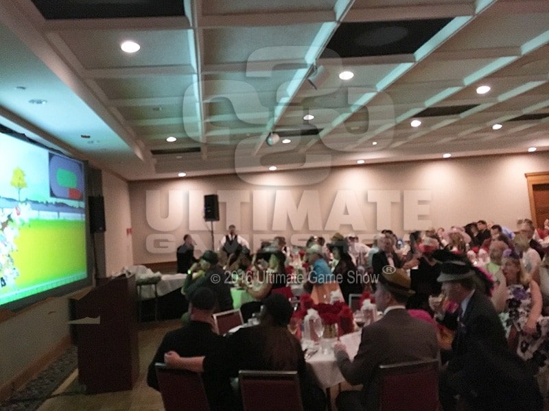 Ultimate Game Show presents custom animated horse racing at a company banquet.