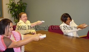 A small group trains with the Audience Response Keypad system from The Ultimate Game Show.