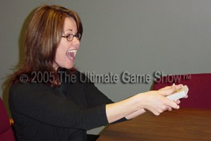 A meeting attendee excitedly participates using Ultmate Audience Response.
